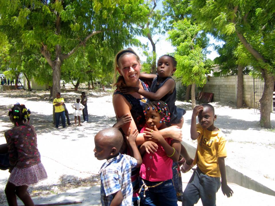 Megan loving on the Haitian Children.